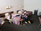 "2013.23.3 - Fun in the cozy hotel room at the ""Prairie Inn""Evanston, Wyoming"
