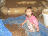 2013-12-28 : Our Marlee playing in the clay