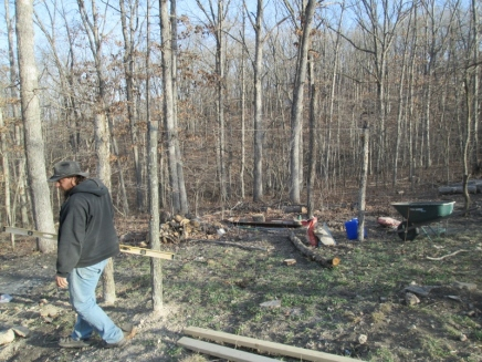 Strings helping us mark the logs to be cut off level, and also to help us decide where to dig in the center posts.