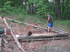 Tim using felled trees to create this cool hugelkultur terrace