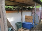 Here is Section 2, still have to hang the cages in here, so we use it to store feed and other stuff for the time being.