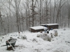 Our livestock barns getting buried in the first snow of the year, Paul and Marlee are just on the other side of the greywater beds collecting snow