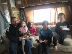 Daddy playing Wii with the kids