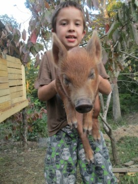 Gage picking up the pig... not for long though, lol