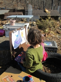 The girls enjoying today's wonderful weather to paint with their water colors.