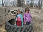 To show how big these tires are, my cute little super-sheros, Rynae & Marlee